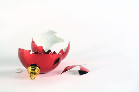 A shattered chrismas ball on a white background