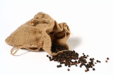 hessian bag: Black pepper spilling out of a small hessian bag.