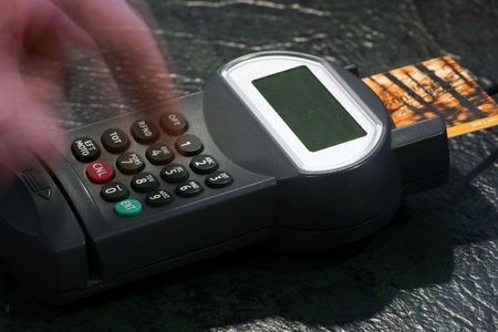 A credit card being used and pin entered. Stock Photo
