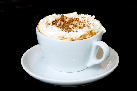 A cup of mocha on a black background.