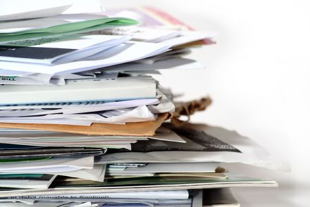 A pile of paper work that needs to be filed.
