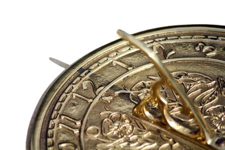 sun dial: A brass sun dial with white background.