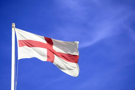 flagging: A Enland flag with a blue sky background.