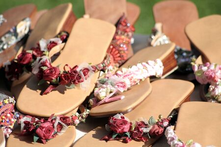 sandels: Sandals for sale at a farmers market in England. Stock Photo