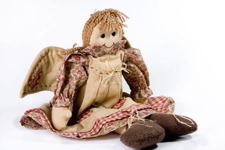A handmade rag doll angel isolated on a white background. Standard-Bild