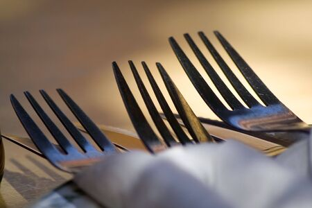 Sets of knife and forks with shadow and sun casts.  Stock Photo - 2725796