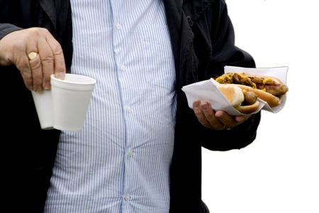 An over weight man with fast food in his hand.