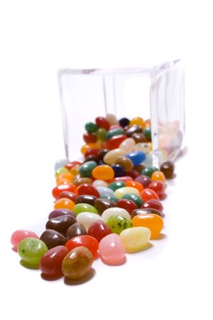 Jelly bean candy from a glass container isolated on a white background. Stock Photo - 2759398