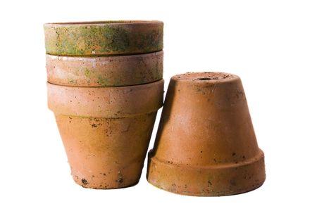 Four terracotta pots on a white background. Standard-Bild