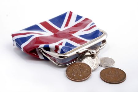 A small perch with a British flag and UK coins.