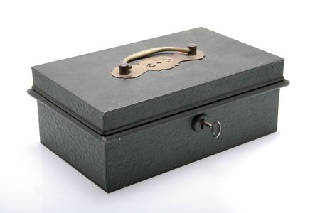 An antique cash box with key on a white background.