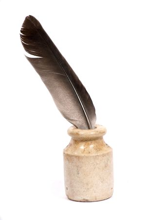 A pigeon feather pen and ink pot on a white background. Stock Photo - 4579415