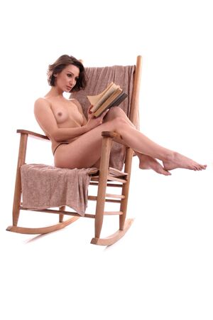 woman reading: Image of a topples woman sitting in a rocking chair reading a book.