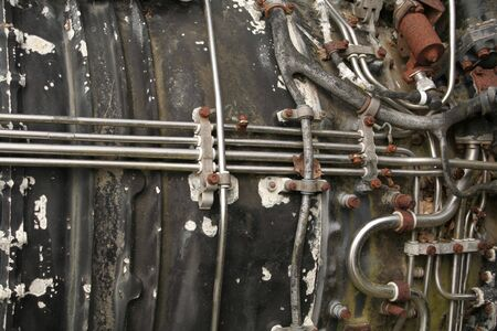 Close-up of an old rusty jet engine. photo