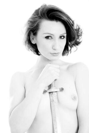 Black and white image of a beautiful woman holding a sword. photo