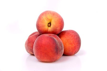 Four peaches in a stack on a white background. Stock Photo - 5240702