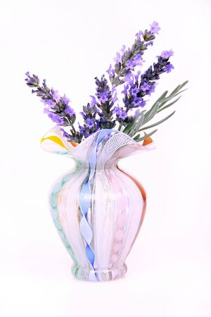 dried flower arrangement: An old antique glass vase with fresh lavender.