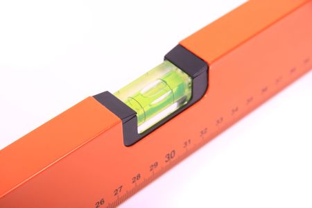 Close-up of a spirit level with the level bubble in the middle.  photo