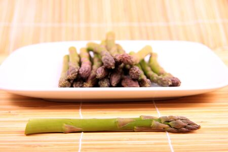 fibber: A bunch of fresh asparagus on a white plate. Stock Photo