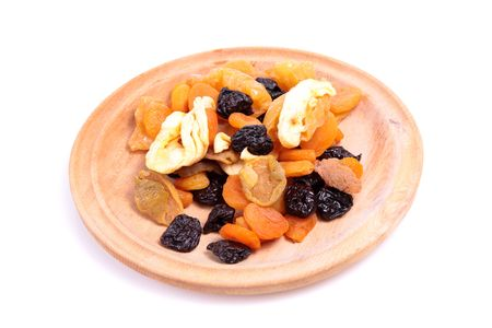 Dried fruit mix on a wooden plate. Stock Photo - 6613241