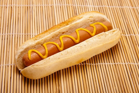 An American hot dog with mustard.  photo