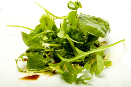 A small herb salad on a white background.  Standard-Bild