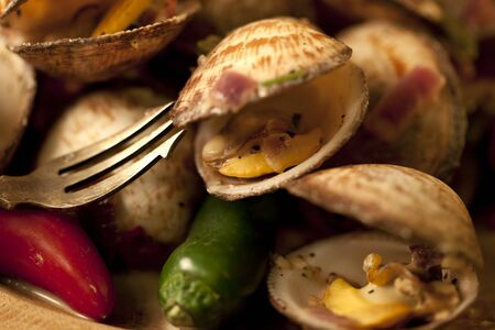 Chili flavoured clams on a wooden plate ready for eating. Stock Photo - 9244153