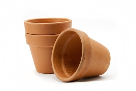 Three terracotta plant pots on a white background.  Stock Photo