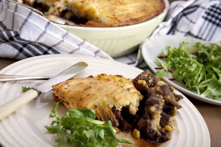 meat pie: A delicious home made meat pie on a wooden table that makes your mouth water.