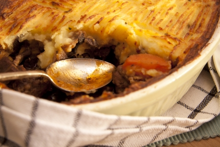 minced beef: A delicious home made meat pie on a wooden table that makes your mouth water.