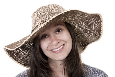 thirty something: A beautiful and happy thirty something woman wearing a hat.  Stock Photo