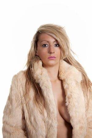 A young sexy woman just wearing a fur coat.  photo