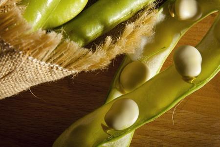 hessian bag: Fresh broad beans in Hessian bag on a market stall.