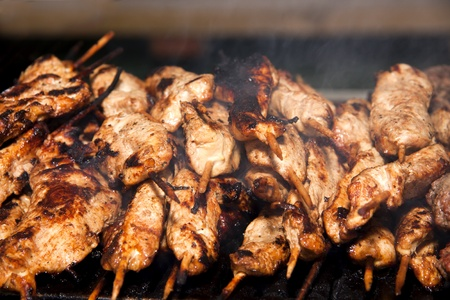 Fresh chicken wings being cooked on an outdoor barbeque for an alfresco meal. photo