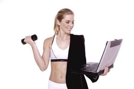 A young blond businesswoman doing exercise. Stockfoto