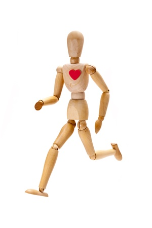 A image of a wooden mannequin running as a concept for healthy living  photo