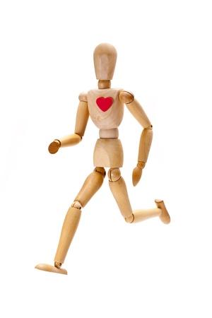 mannequin: Una immagine di un manichino di legno in esecuzione come un concetto di vita sana