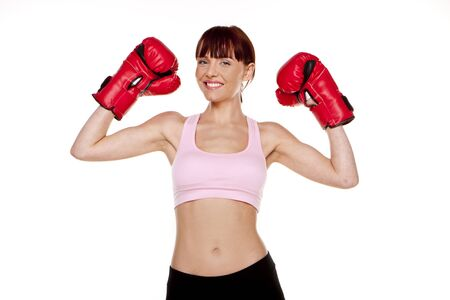 A fitness Woman wearing red boxing cloves ready to do boxersice   photo