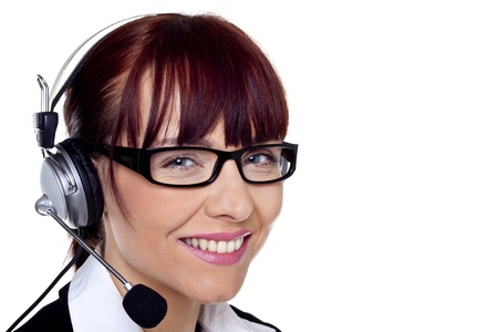A beautiful customer service representative talking on a helpline   Stock Photo - 12717706