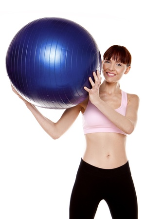 A fitness woman doing exercises with a blue gym ball   Stock Photo - 12718073