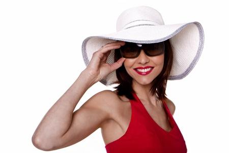 Een mooie vrouw dragen van een hoed en een zonnebril Stockfoto - 12718087