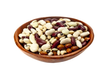 Healthy dried mixed beans on a white background.  photo