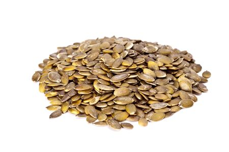 fibber: Healthy dried pumpkin seeds on a white background.