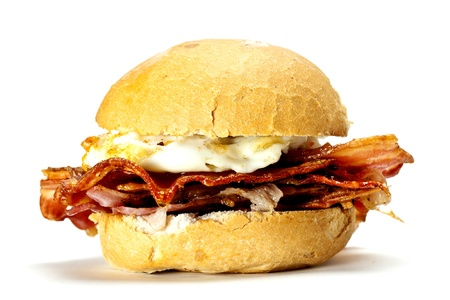 bap: A delicious bacon and egg bun on a white background. Bacon and egg bun.