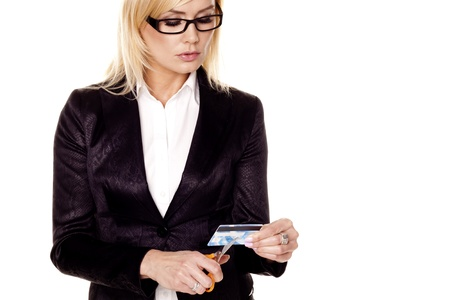 A young businesswoman is cutting up a bad credit card on a white background   photo