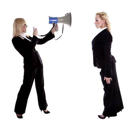 A beautiful blond businesswoman shouting trough a megaphone at herself  photo