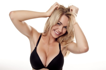 A very sexy blond woman wearing a black bra on a white background  Stock Photo