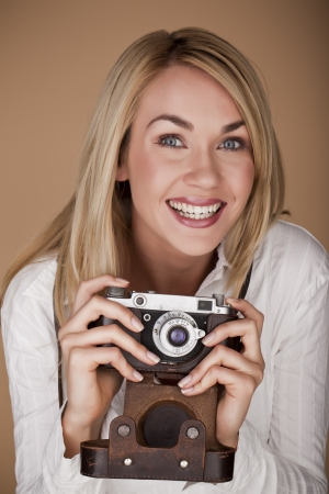 A happy and fun loving female photographer enjoying her work  photo