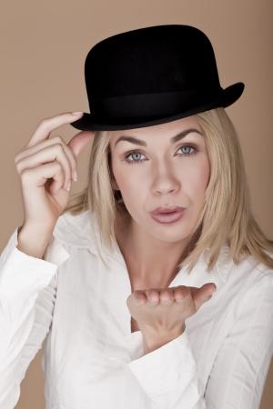 A beautiful blond woman wearing a bowler hat  photo