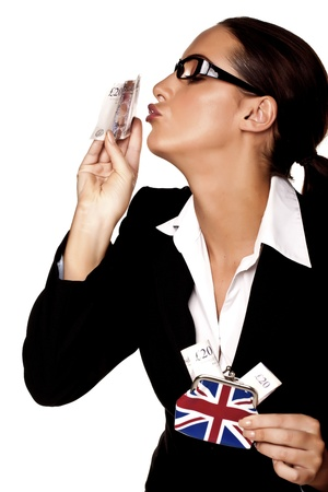 A beautiful businesswoman holding a money purse with twenty pound notes in it  photo